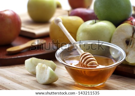 Honey and apples - stock photo