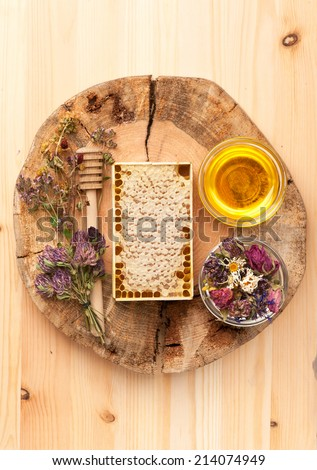 Honey and dried herbs - stock photo