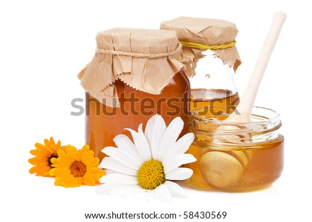 honey and flowers on white - stock photo