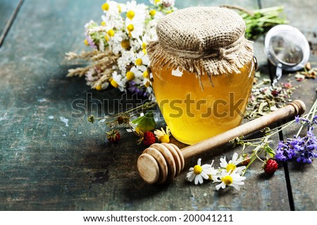 Honey and Herbal tea on wooden background - summer, health and organic food concept - stock photo