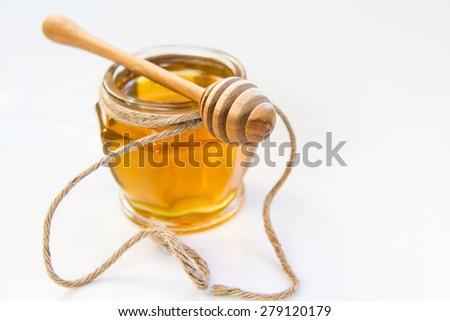 Honey and honey scoop - stock photo