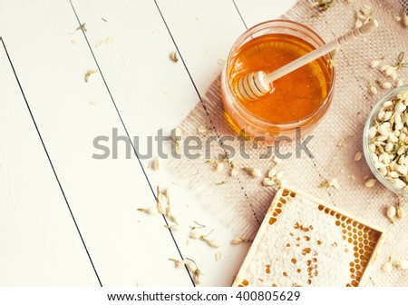 Honey and honeycomb with jasmine with copyspace - stock photo