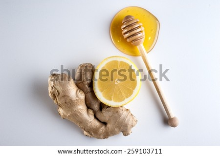 Honey and lemon on  a white background - stock photo