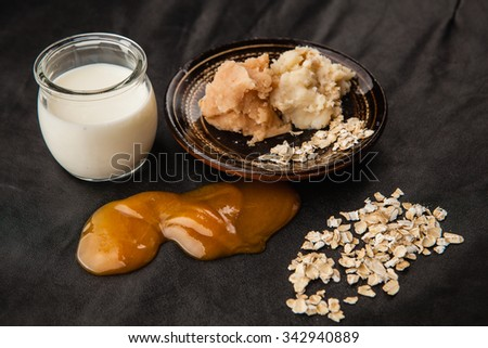 Honey and milk handmade soap with oats in a clay bowl - stock photo