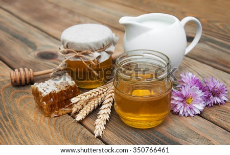 honey and milk on a old wooden background