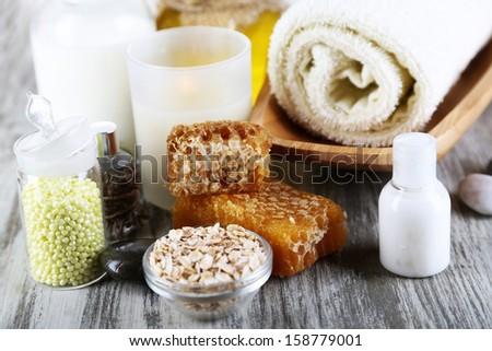 Honey and milk spa with oils and honey on wooden table close-up - stock photo