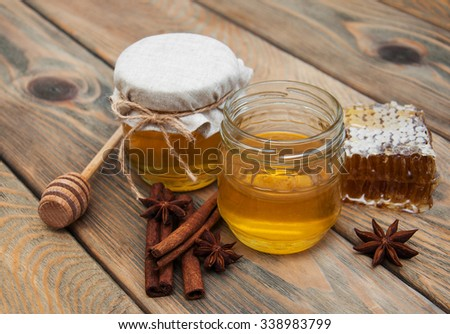 honey and spices on a old wooden background