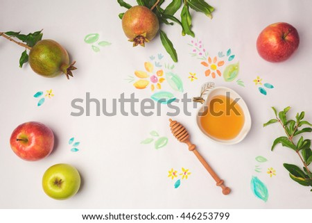 Honey, apples and pomegranate on paper background with watercolor flowers. Jewish holiday Rosh Hashanah celebration concept.