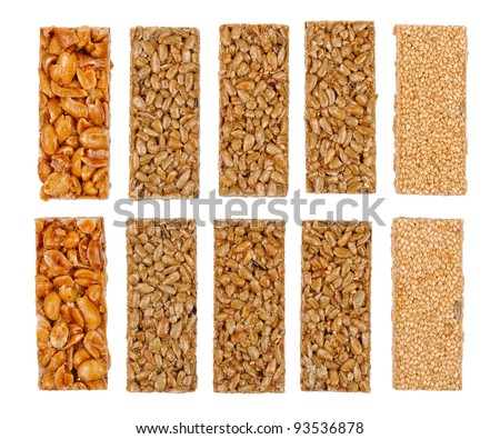 Honey bars with peanuts, sesame and sunflower seeds isolated