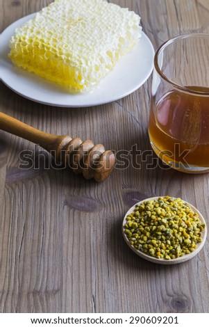 Honey, bee pollen and honeycomb - stock photo