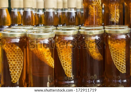 Honey bottled. - stock photo