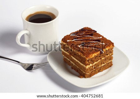 Honey cake and cup of coffee on white background  - stock photo
