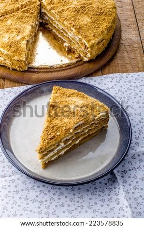 honey cake on a wooden background - stock photo