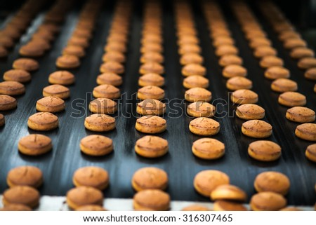 Honey-cake  on the production line at the bakery  - stock photo