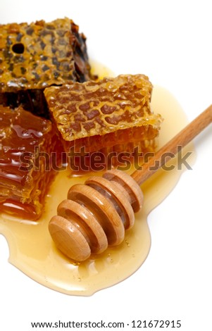 honey comb and dipper over white - stock photo