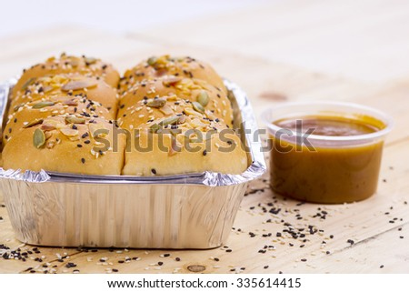 honey comb bread and sweet cream on isolated background - stock photo