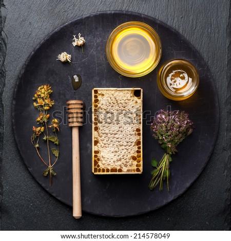 Honey comb on dark grunge background - stock photo