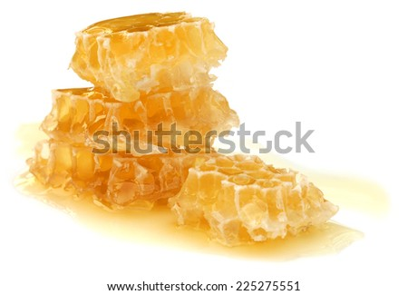 Honey comb over white background - stock photo