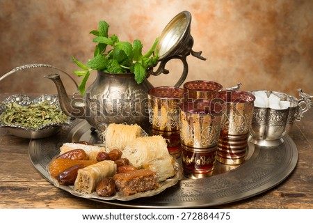 Honey cookies and dates on a Moroccan tea tray - stock photo