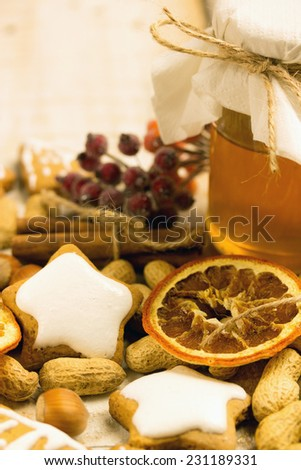 honey cookies with nuts and orange and honey on a table