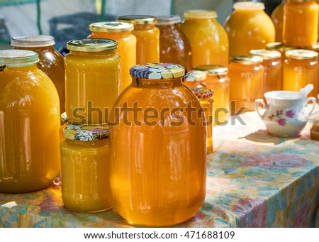 Honey different grades in glass container
