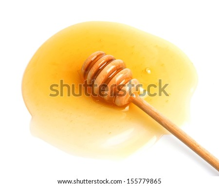 Honey dipper close up on white  - stock photo