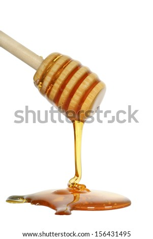 honey dipper with honey on white - stock photo