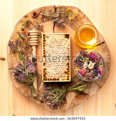 Honey, dried herbs and herbal tea. top view - stock photo