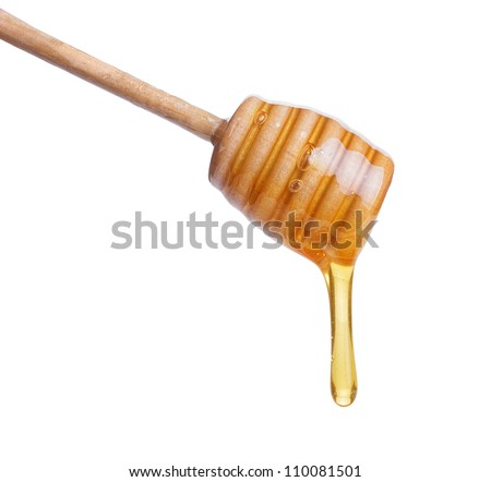Honey dripping from  wooden  stick isolated on white background - stock photo