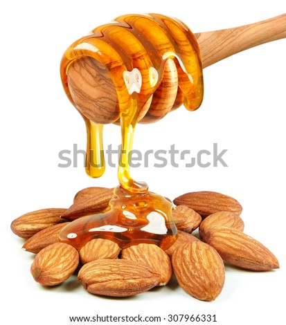honey dripping on almond nuts isolated on white background - stock photo