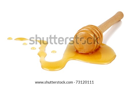 honey flowing down from a wooden stick isolated on white background