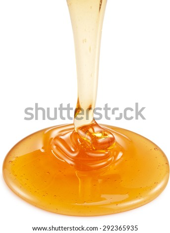 Honey flowing from wooden stick on white background. Clipping paths. - stock photo