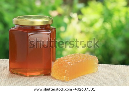 Honey from nature pollen flower and honey soap with green background. - stock photo