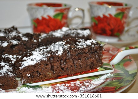 Honey gingerbread cake with cocoa and honey. Very tasty and healthy dessert. Food, pastries. Ingredients: sugar, water, raisins, nuts, vegetable oil, flour, honey, soda, baking powder, cocoa - stock photo