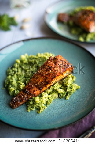 Honey glazed salmon Fillet on a bed of vegetables - stock photo
