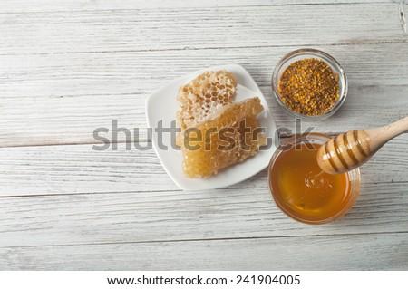 honey, honeycomb, pollen - stock photo