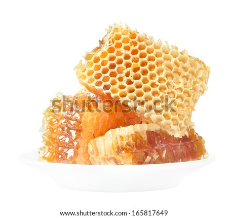 Honey honeycombs and pollen on plates on a white background - stock photo