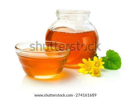 Honey in a glass jar isolated on white - stock photo