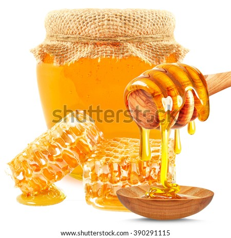 honey in a jar, honeycomb and spoon isolated on white background - stock photo