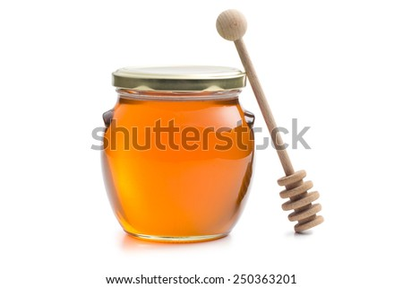 honey in a jar on white background - stock photo