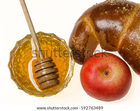 honey in glass bowl with apple and croissant on white background