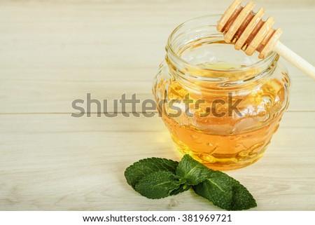 honey in jar with honey dipper - stock photo