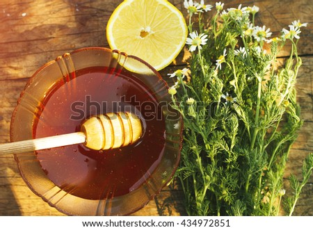 Honey in jar with honey dipper - stock photo
