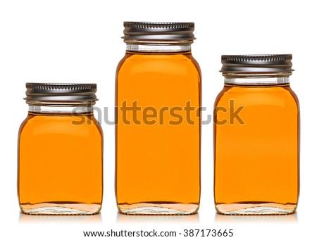 Honey in jars on white background - stock photo