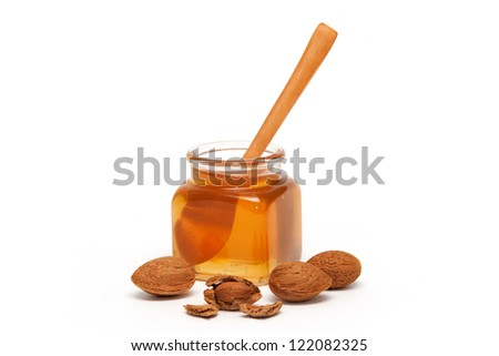 Honey in the jar and almonds - stock photo