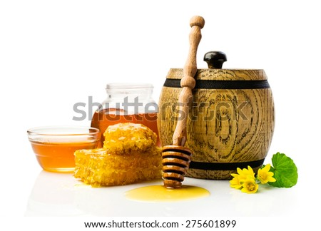 Honey in wooden barrel with honeycomb isolated on white - stock photo