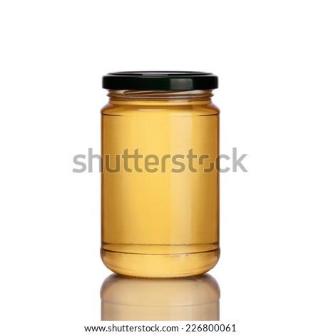 honey jar on white background - stock photo