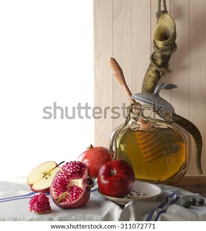 Honey jar with apples and pomegranate Rosh Hashana hebrew religious holiday - stock photo