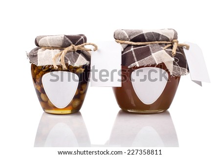 Honey jars with blank labels - stock photo