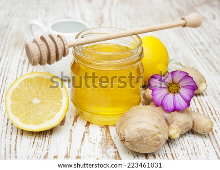 honey,  lemon and ginger on a wooden background - stock photo